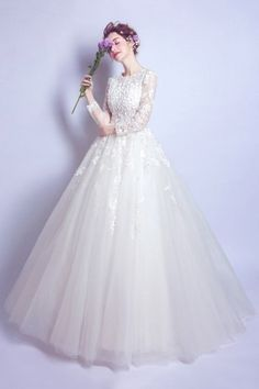 5cb31443f57 Robe mariée 2017 princesse vaporeuse manches longues bustier fleuri