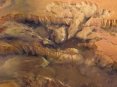 Martian canyon,VallesMarineris:   An image captured by the ESA's Mars Express craft, as it orbited overthe magnificent Martian canyon known asVallesMarineris. Image courtesy G. Neukum, F.U. Berlin/DLR/ESA[via National Geographic]