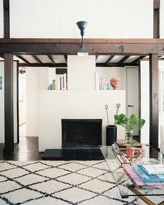 A cozy, unfussy fireplace in East Hampton