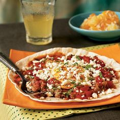 "Huevos Rancheros with Queso Fresco ""This is wonderful for a quick weeknight meal,"" says bellymama. ""Our two-year-old was happy eating a quesadilla and fried egg with the beans on the side!"" Menu Tip: Mix together a can of pineapple chunks, a jar of orange slices, and 2 tablespoons of powdered sugar. Then sprinkle with sweetened coconut for a quick side for this Mexican-Style Breakfast for Dinner."