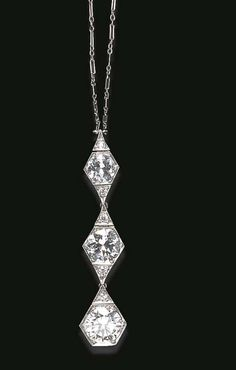 A DIAMOND PENDANT NECKLACE  The articulated pendant, designed as a series of three old European-cut diamond geometric links, suspended from a fancy-link chain, joined by a old European-cut diamond marquise-shaped clasp, mounted in platinum, circa 1925, 16 ins.