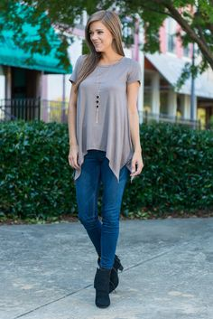 """Stay With Me Tee, Taupe""You'll want this top to stay with you forever once you realize how comfy and cute it is! The jagged hemline is keeps this from being just another basic tee. #newarrivals #shopthemint"