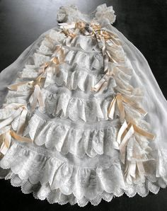 This gown  dates from around the turn of the last century, from about 1890 to perhaps 1920, that era known in France as 'La Belle Epoque.'