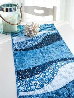 """An easy project to whip up for the holidays!   This table runner and place mat pattern is perfect for all those large-scale prints that have been giving you that come-hither look. Quick-to-stitch and super trendy, the finished project makes for a great gift for any special person in your life. You can jazz up the finished look by adding some extra stitches here and there, embellishments, and your favorite fabrics.  Finished sizes:  Table runner: 15"""" x 47""""  Place mats: 14"""" x 18 1/2"""" each"""