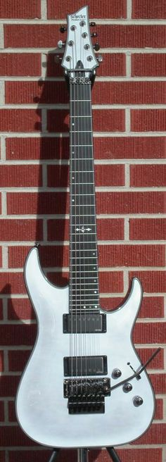 What would be a good topic for an argumentative research paper about music or guitar?