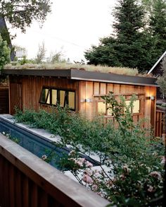 Wooden garage with green roof