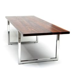 """GAX Dining Table 84x36 $4555 - gorgeous, heavyweight dining table modeled after a butcher's block—but made for the finest dining rooms. solid top made of hard walnut wood with a hand-rubbed oil finish that eliminates the need for coasters, and marine-grade stainless steel legs hand-polished to a reflective sheen. Designed by Alejandro Artigas for ARTLESS Clean with an orange oil wood cleaner. Oil Rubbed Solid Walnut, Stainless Steel Made in the USA L 84"""" W 36"""" H 30"""" Weight: 210 lbs"""
