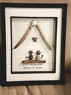 Pebble art cats make our house a home