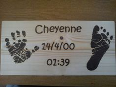 Handprint, footprint, and details of birth plaque.