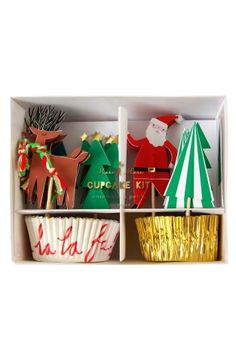 Meri Meri 'Very Merry' Cupcake Kit (24-Pack). Festive handcrafted cupcake papers and merry toppers will charm guests at your next Christmas party.Contains 24 cupcake cases and 24 cupcake toppers