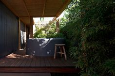 Tiled spa in the garden at the Fawkner Street Residence by B.E Architecture