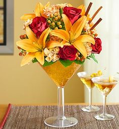 Martini Bouquet™ Pumpkin Spice- fresh roses, lilies, hypericum, mini carnations and salal, topped with cinnamon sticks for a little extra spice