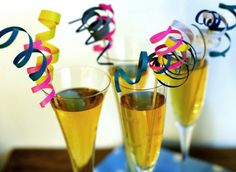 Simple but cute drink decoration idea- 1. Cut colorful card stock into strips 2. Wrap each strip around a pencil to curl it 3. Glue the curled strips to the end of a kitchen skewer