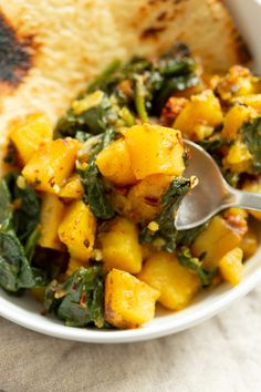Garlic Potato Spinach Stir fry with Naan bread in a white bowl Spinach Indian Recipes, Indian Food Recipes, Ethnic Recipes, Potato Spinach Curry, Garlic Spinach, Entree Recipes, Vegan Recipes Easy, Rice Recipes, Masala Sauce