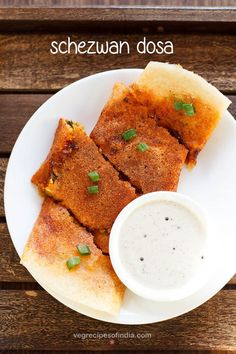 schezwan dosa recipe with step by step photos - crispy and spicy schezwan dosa recipe. schezwan dosa is one of the fusion street food offered by the street vendors in mumbai. its basically a fusion of