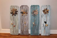 Reclaimed Wood Sign,3D Rock Flowers on Reclaimed Fence Pickets, Reclaimed Wood, Rustic Home Decor, Wall Art, Wall Hanging, Wood Wall Art by CSquaredCustoms on Etsy https://www.etsy.com/listing/202354353/reclaimed-wood-sign3d-rock-flowers-on