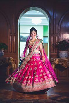 Looking for Bride twirling in red lehenga with gold motifs? Browse of latest bridal photos, lehenga & jewelry designs, decor ideas, etc. on WedMeGood Gallery. Pink Bridal Lehenga, Lehenga Wedding, Pink Lehenga, Indian Bridal Lehenga, Bollywood Lehenga, Shaadi Lehenga, Sabyasachi Lehengas, Ghagra Choli, Sharara