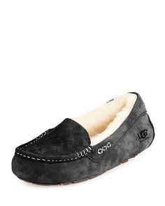 Water-resistant suede slipper by UGG, the epitome of relaxed luxury. Lined with UGGpure 100% wool. UGG slipper fuses fashion and comfort. Squared toe with moccasin stitching. Wool insole. Flat heel. L