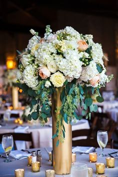 Stunning Tall Wedding Centerpieces; photo: Mike Reed Photo by ila
