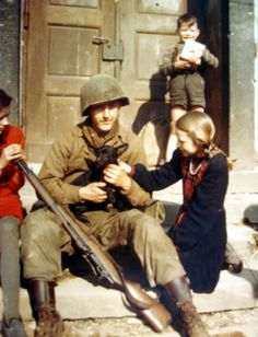 WW II - Soldier with children and puppy
