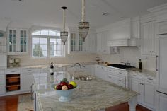 Traditional L-shaped Cream kitchen, white cabinets,