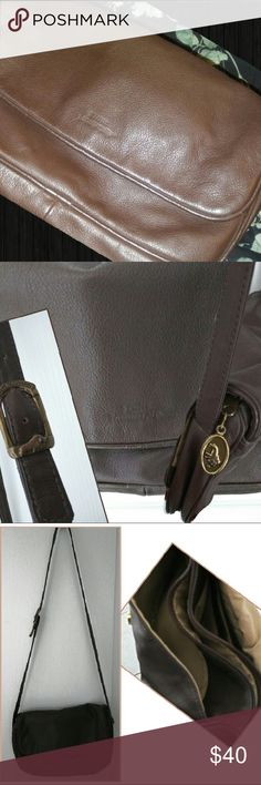Beautiful Stone Mountain Leather Crossbody This is a beautiful leather crossbody by Stone Mountain. The color is a luxurious chocolate brown and it will go with all of your spring and summer attire!  Wear as a shoulder bag or as a crossbody by simply adjusting the strap!  This bag is in MINT condition! No rips or tears! Please like or share our closet, new items added daily! Rock'N Ship USA! stone mountain Bags