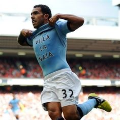 Manchester City's Carlos Tevez celebrates after he scores the second goal of the game for his side during their English Premier League soccer match at Anfield in Liverpool, England, Sunday Aug. 26, 2012.