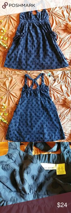 Beautiful DKNY Dress Gently used with adorable ruched pocket detailing! This is a super cute dress that can go casual, classy, or nautical depending on how you want to style it!  Size xsmall Lined 55% polyester; 45% cotton Color: navy blue with polka dots in a darker navy blue Side zipper DKNY Dresses