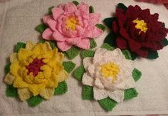 More flowers- pattern  from http://makemydaycreative.com/2014/03/06/water-lily/.  I added the last green round as the leaves