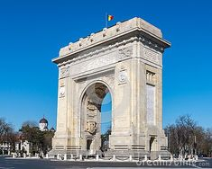 Arc de Triumph in Bucharest, a famous copy of the one in Paris, during a sunny autumn day.