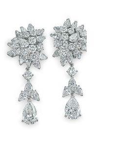 A pair of diamond ear pendants, by Van Cleef