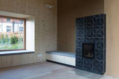 """KARAK designer tiles. VeSta, """"Schwarz"""" glazing with Raku firing. Haus Gastein, Bad Gastein, Austria. Imgang Architekten, 2013. Bad Gastein, Panama, Designer, Objects, Interior, Home Decor, Fireplace Heater, Architects, Tile"""