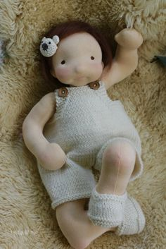 Baby Maia, a waldorf inspired, natural fiber art doll by Fig and Me. Wearing her pretty woollen overalls and her bear barrette. So cute the little stinker!.