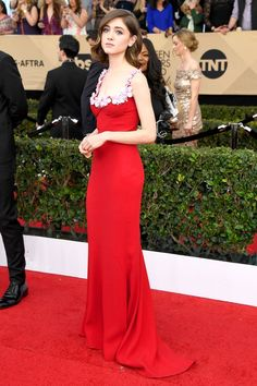 Natalia Dyer in an embellished red Miu Miu dress with an Edie Parker clutch, Nicholas Kirkwood shoes, and jewelry by Jacob & Co. at the 2017 Screen Actors Guild Awards.