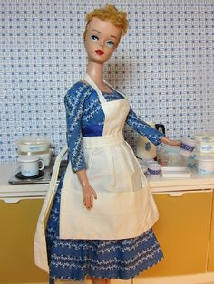 Beautiful vintage Barbie displayed in a vintage style kitchen setting.