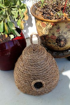 Summer is on it's way, and we all know that it's time to get our porches ready for these warm days. This cute rope beehive is just the thing to add a touch of vintage style to your porch! You can make it for under $10, so check out the tutorial and make one today!