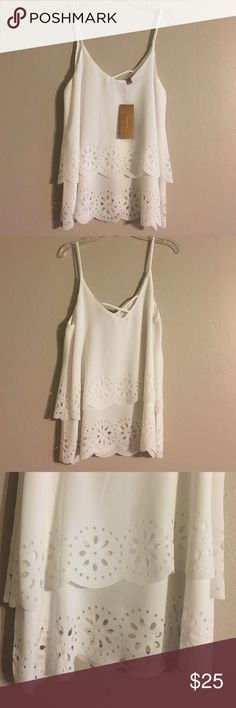 NWT Francesca's white top White tank top with laser cut outs at the bottom. Was purchased at Francesca's boutique. Size small. New with tags. Smoke free home. Price is negotiable. Make me an offer! Francesca's Collections Tops Tank Tops