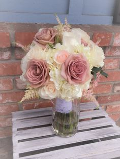 Mauve & light pink roses with white hydrangea make this beautiful bouquet.