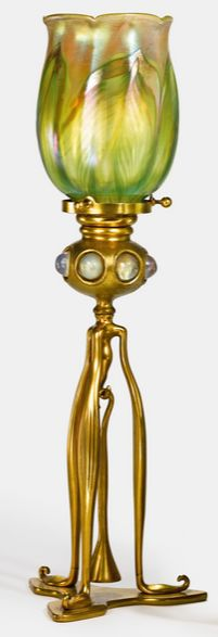 Tiffany Studios, JEWELLED CANDLESTICK with snuffer, shade engraved L.C.T., base impressed TIFFANY STUDIOS NEW YORK1212B, favrile glass and gilt bronze, circa 1910.