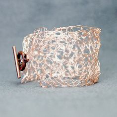 Rose gold wire weaves in and out creating a unique rose gold cuff bracelet perfect for any wedding. The strong yet delicate rose gold bracelet is made by crocheting wire into an organic and bohemian design. This weaving creates durability and makes the alternative bridal bracelet tough to break and damage.  - Rose Gold Cuff Bracelet - Wire Crochet / Wire Weaved Bracelet - Perfect for any Boho Bride or Alternative Wedding - Made to Fit You Upon Ordering  *DIMENSIONS* The rose gold bracele...