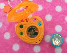 Mars Power! Make Up!!  Show off your Sailor Moon love with this fantastic one of a kind locket necklace. This item was handmade by me using a rare vintage Sailor Mars gashapon toy, rainbow star charms and chain. And the coolest part is the locket opens up to reveal a hidden image of Rei-chan! N...