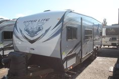SWEET TRAVEL TRAILER TOYHAULER!  2016 Forest River XLR Hyper Lite 27HFS  Bring your toys! With a 9' garage, there is plenty of room! A U-shaped dinette makes for extra elbow room at the table! Cozy up in your large bed after a day of fun! Having all your toys on your trip will have you staying outside until dusk! Don't miss out on this deal! Call our XLR Hyper Lite expert Josh Peterson 435-774-0106