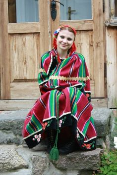 Folk costume from Łowicz, Poland.  My grandmother was from County Lowicz.  God could she ever sing!