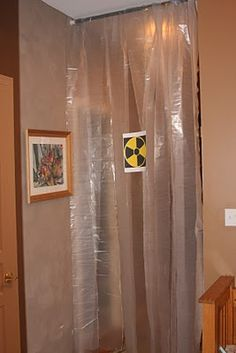Creative use of a shower curtain for a science-themed kids party. Touches like this really make a party memorable.