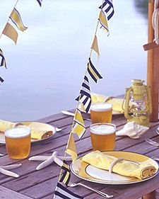 Salute guests at your next outdoor party with garlands made from ribbon in nautical-themed stripes and solids. We swagged the decorative banners between a lakeside picnic table and umbrella; they can also festoon porch posts or deck railings.  (read more)