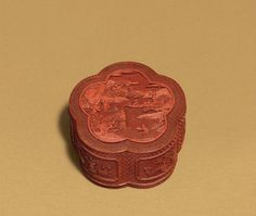 A finely carved cinnabar lacquer lobed box and cover, Qianlong period (1736-1795)