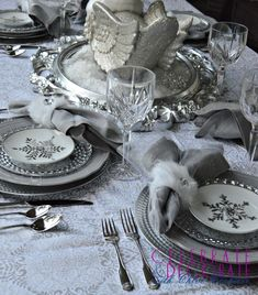 A Winter Wonderland Tablescape - all silver and white and snowy! #tablescape #silverandwhite #winterwonderland #swan