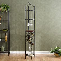 @Overstock - This beautiful black wine storage rack adds style and personality to your home while providing ample storage space for up to 8 bottles of wine. Its modern, open look makes this rotunda a perfect display case for your wine and beverage collection. http://www.overstock.com/Home-Garden/Round-Metal-Wine-Storage-Tower/3684085/product.html?CID=214117 $76.99