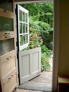 Dutch Door in the kitchen lets the heat out but keeps little guys in.