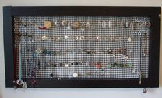 My mom made me an earring holder similar to this... but with a coat hanger. I love this framed idea.